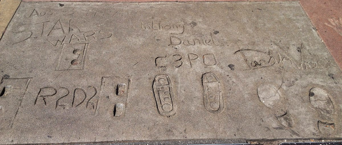 The footprints of R2-D2 (Kenny Baker), C-3PO (Anthony Daniels) and Darth Vader (David Prowse) at the Chinese Theatre in Hollywood. (Photo by Erik Tryggestad)