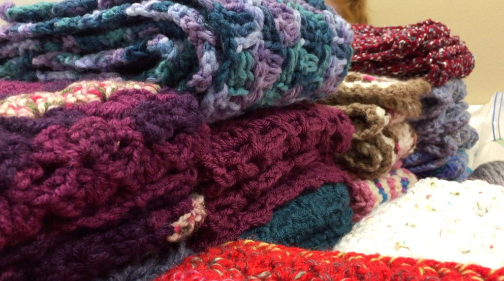 A sampling of the scarves made by volunteers with Threads of Compassion.