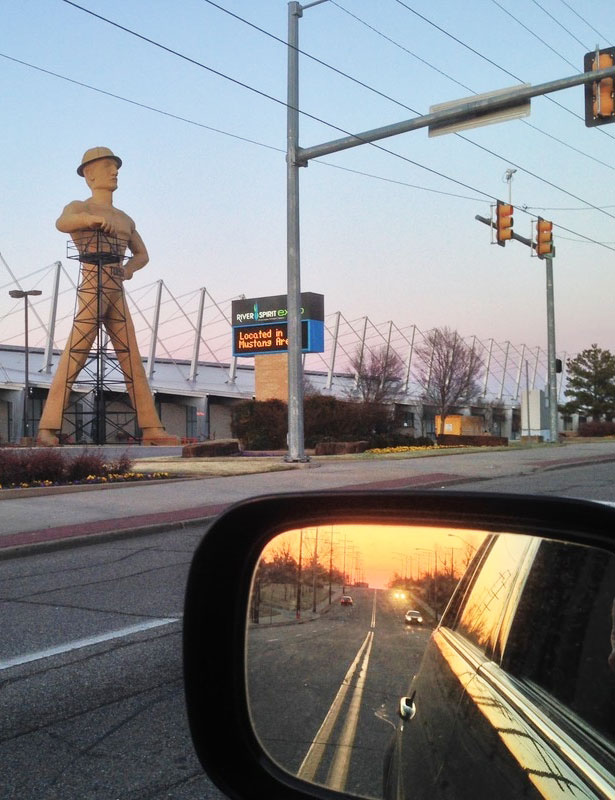 The sun sets on the Golden Driller statue at the Tulsa Expo Center in Oklahoma