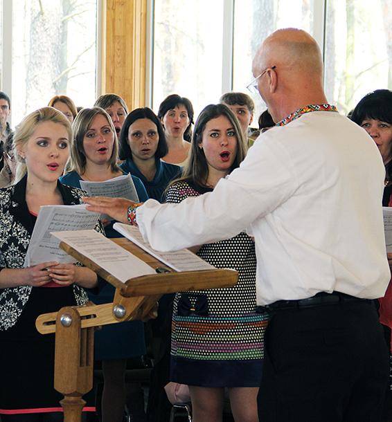 Stan Bryan leads Ukrainian church members during a singing festival in Irpin