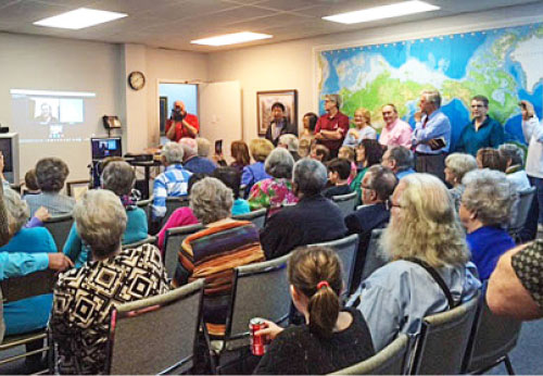 About 100 people gather at World Christian Broadcasting's headquarters in Franklin