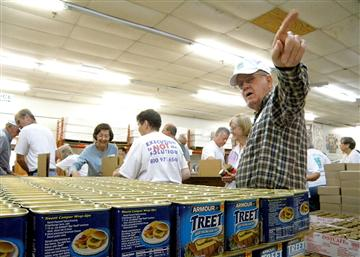 Volunteers pack relief boxes at the headquarters of Churches of Christ Disaster Relief Effort in Nashville