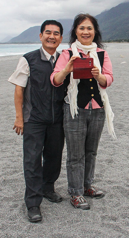 Ruth Lu and husband Boaz Wang take a photo of visitors at a beach near Hualien City