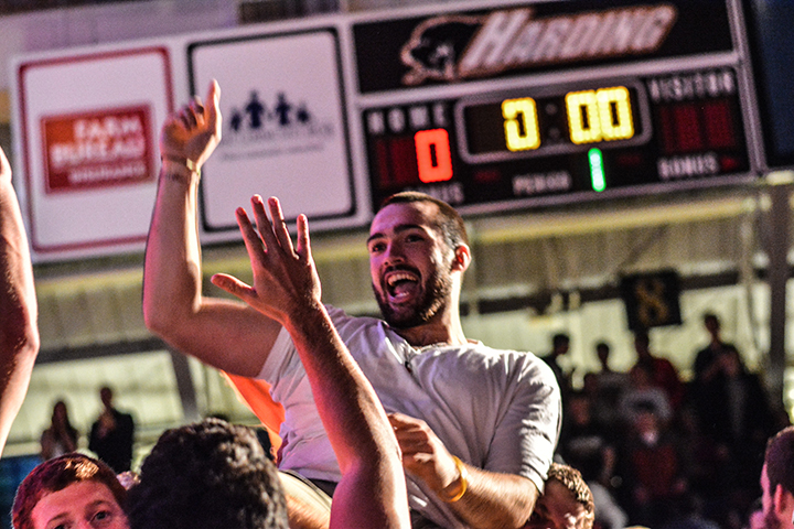 David Brooker is lifted onto the shoulders of Harding University basketball players after hitting a half-court shot and earning half-price tuition for his spring semester.