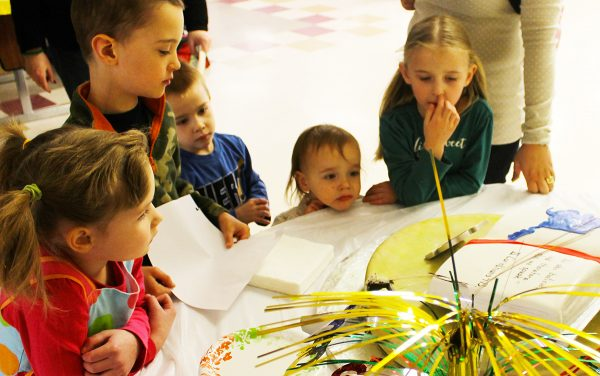 Children admire the cake celebrating the lectureship's 50th anniversary.