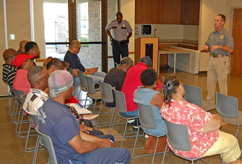 Baton Rouge Police Chief Carl Dabadie Jr. talks to a group of faith leaders during a 'Cops and Clergy' class.