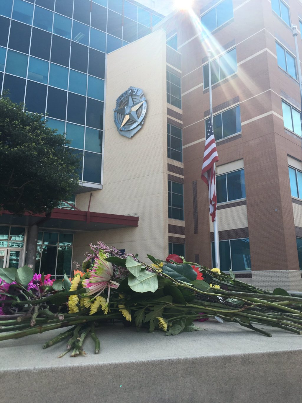 Flowers have been left in front of the Dallas Police Department after five officers were killed