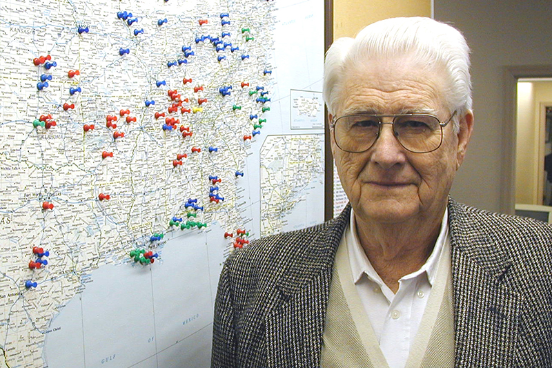 Joe Dudney stands next to a map marking cities where Churches of Christ Disaster Relief Effort has sent supplies.