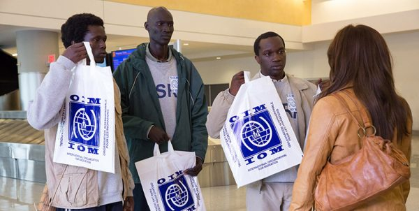 "In the 2014 film ""The Good Lie,"" refugees from Sudan show their ""luggage"" to Carrie (Reese Witherspoon). The white bags come from the International Organization for Migration. Read Erik Tryggestad's review of the film."