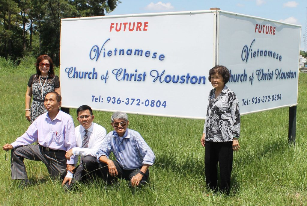 Vietnamese Church of Christ members at the new building site.