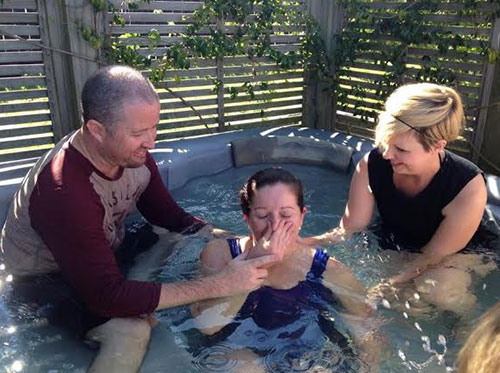 Justin and Jennifer Cherry celebrate a baptism in Auckland