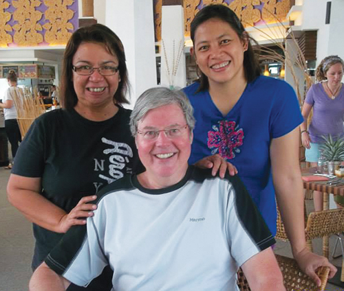 Gigie Carranza and Evelyn Ignacio with song leader Keith Lancaster at the 54th Asia Mission Forum.