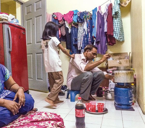 Refugees from Pakistan living in Bangkok, Thailand, prepare tea for visitors. The family of Christians was forced to flee due to persecution by Muslims. The young girl in the photo was shot but survived.