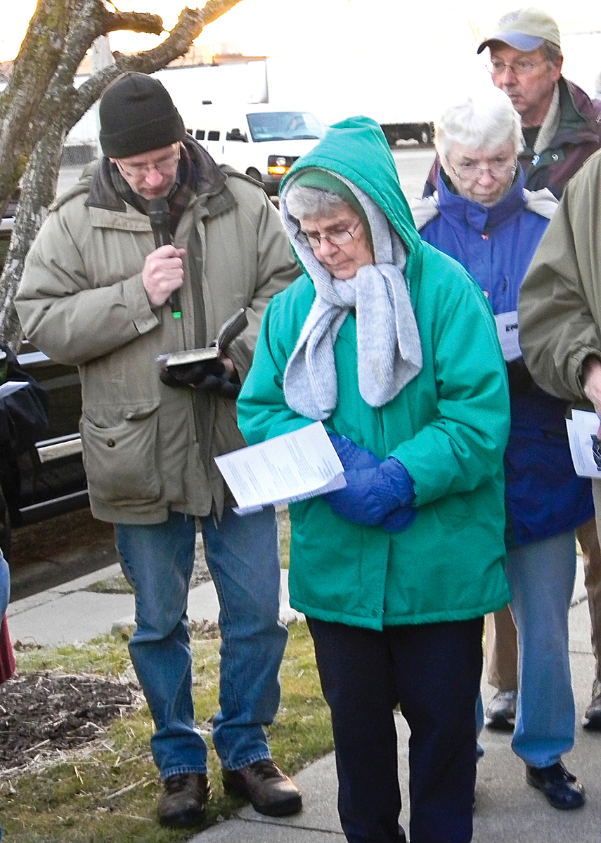Church of Christ minister Bobby Lawson prays at a vigil at a federal deportation center west of Chicago.