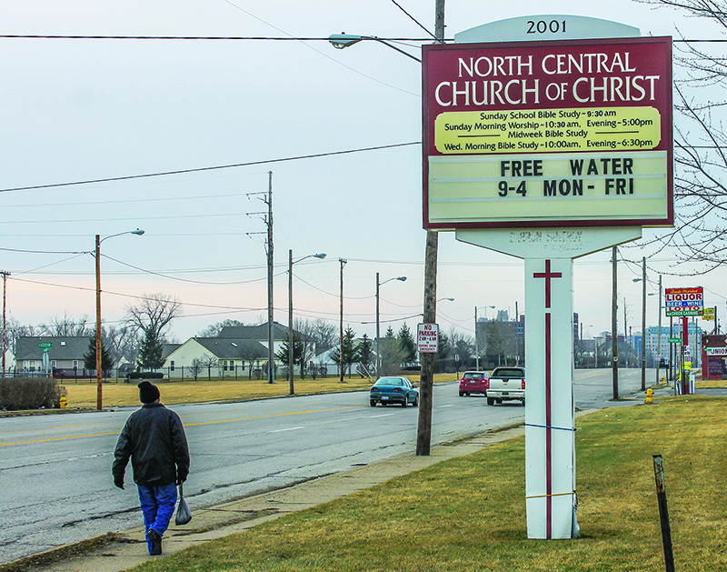 A man walks past the North Central Church of Christ in Flint