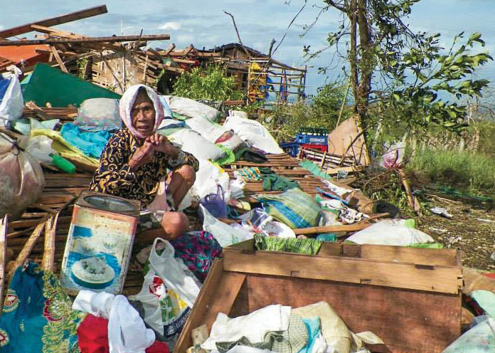 An 80-year-old widow surveys the remains of her home at Arapal Christian Camp on the northern tip of the island of Cebu. (PHOTO PROVIDED)