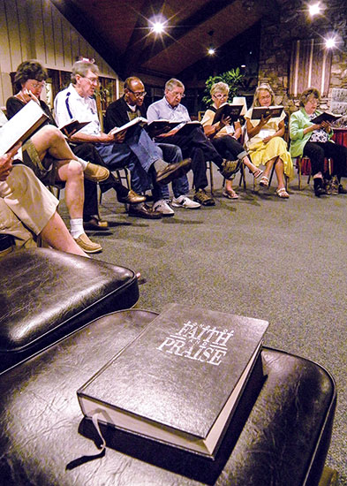 """Attendees gather in the lobby of the Blue Ridge Center to sing following the evening assembly and """"Afterglow"""