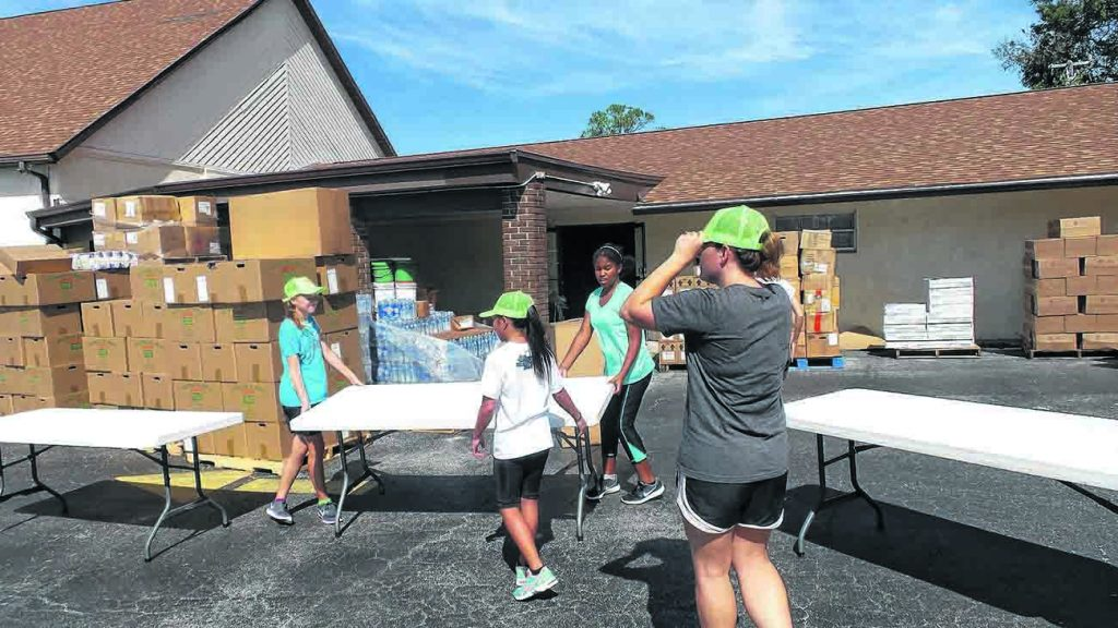 Young volunteers help with the Holly Hill Church of Christ's hurricane relief effort.