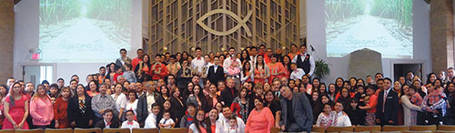 "Some of the 320 Spanish-speaking Christians and visitors who gathered for a recent areawide service at the Elgin Church of Christ in Illinois pose for a group photo. With the theme ""Follow Me"