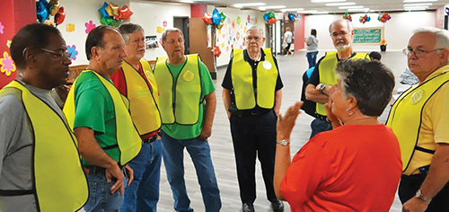 Sherry Ratliff gives instructions to Levy church members who serve as greeters.