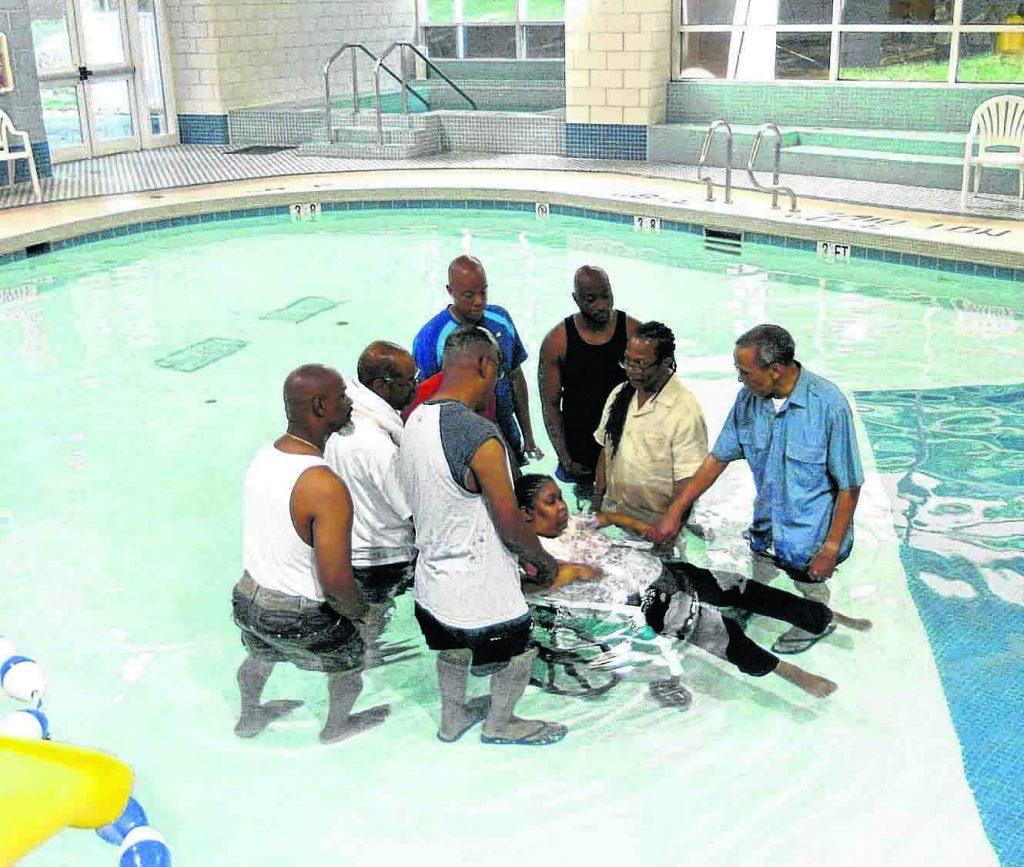 Georgette Morton is baptized in a pool.
