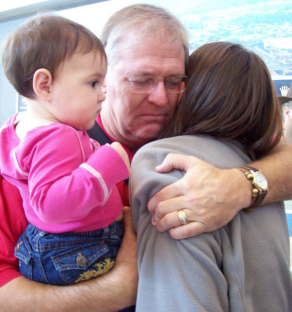 Greg Dunseath says goodbye to his daughter Sarah Beall as she departs Little Rock