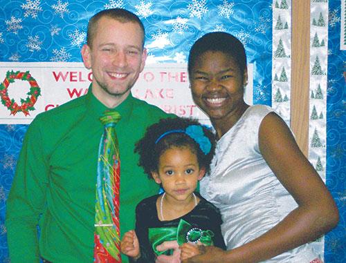 Zack and Sarah Schewe and daughter Mirembe.