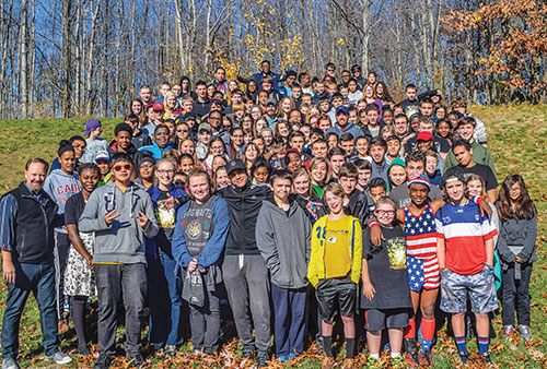 "About 130 attendees from 24 Churches of Christ in six states pose for a group photo at a recent youth rally organized by the Manchester Church of Christ in Connecticut. ""Will You Rise from the Ashes"" served as the youth rally's theme"