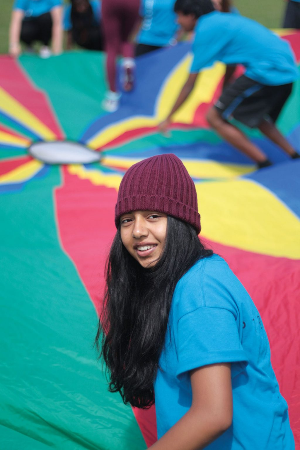 Sanober Sharoon plays a parachute game on the final day of the British Bible Camp