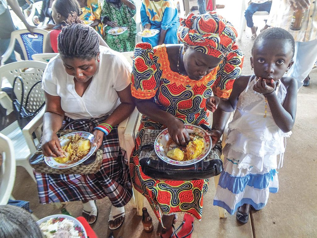 "Christian women of all ages enjoy a fellowship meal provided by the Kampala Church of Christ in the East African nation of Uganda. The meal is part of an annual gathering that ""is not only a celebration Sunday for all our members"