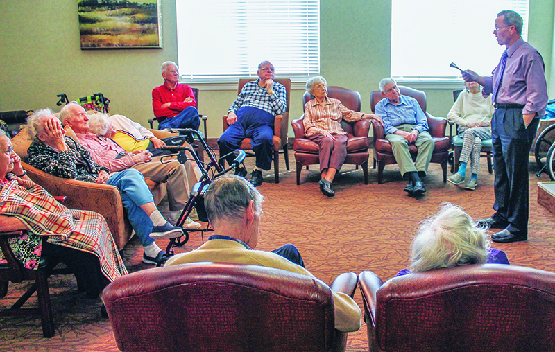 Ray Hunter leads a devotional for memory-care residents at Christian Care Senior Living Community in Mesquite