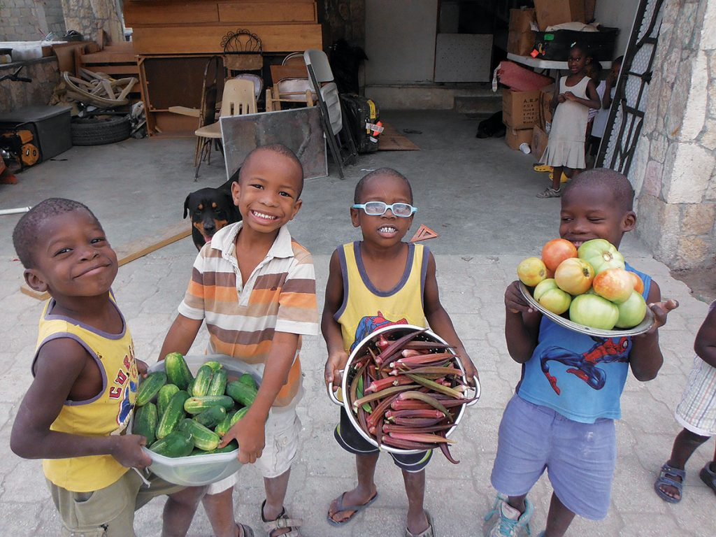 GROWING CROPS FOR GROWING CHILDREN IN HAITI. In Port-au-Prince