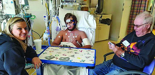 Six days after receiving a new heart, Josh Oakley wanted to play cards. His sister Michelle Leibham and grandfather Duane Earles oblige his request.