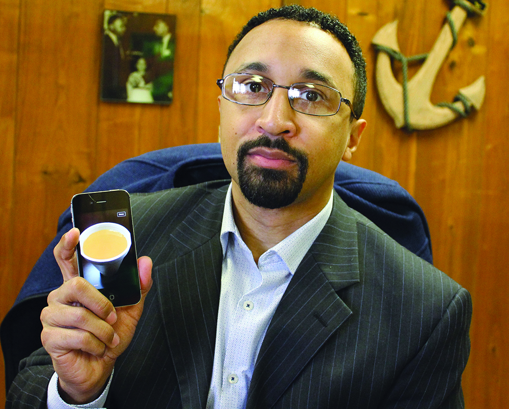 In flint obama listens to church of christ ministers concerns minister rigel j dawson shows a cell phone picture he took of tap water at the north central church of christ in flint mich the water was the color of publicscrutiny Gallery