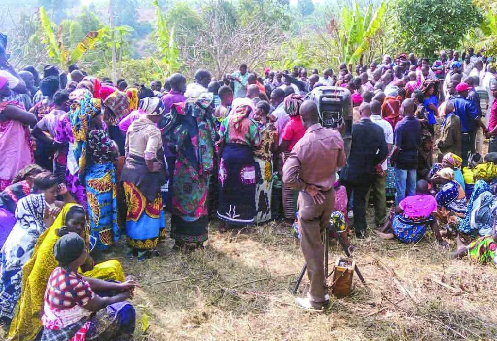 Crowds gather to remember the life of Anthony Mwaihojo in rural Tanzania.