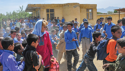Jan Bradley gets smiles from dozens of students at a school in Afghanistan's Parwan Province