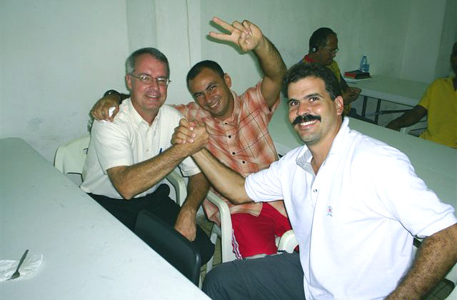 Kirk McAfee with Cuban ministers Amaury Aguilera Wong and Kadir Monguila.