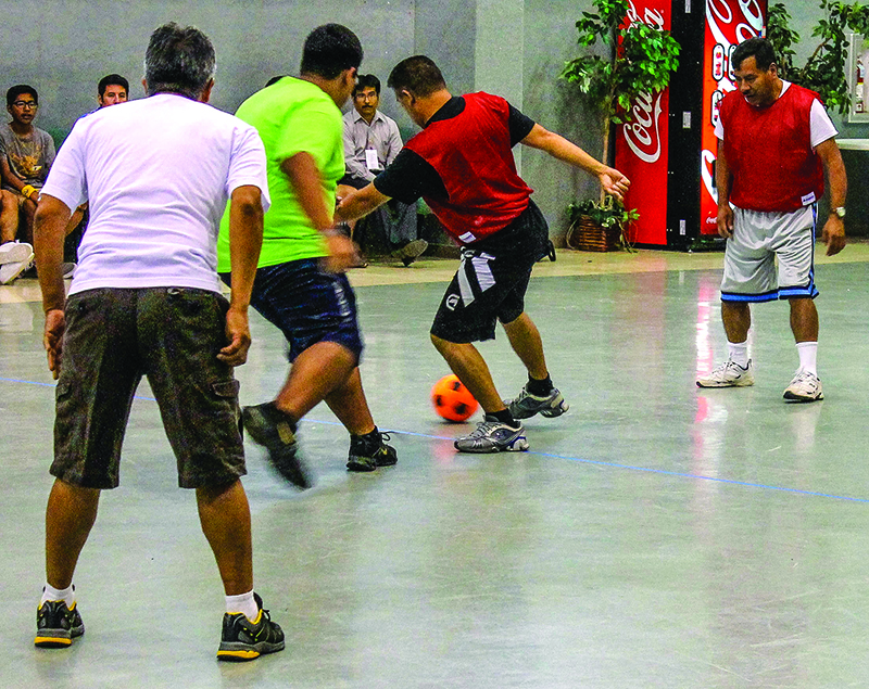 Preachers and ministry leaders play soccer in the Northside Church of Christ fellowship hall during the 12th annual National Meeting of Preachers.