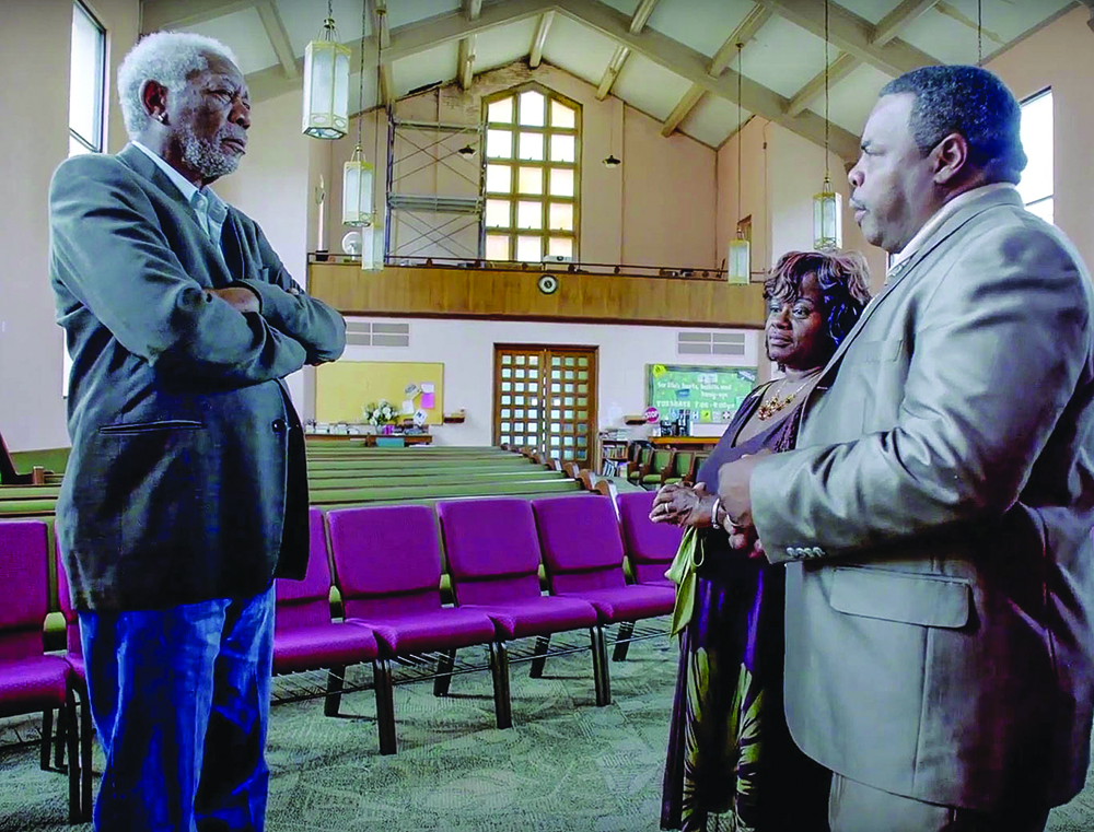 Morgan Freeman interviews hurricane survivors Charles and Angela Marsalis at the Carrollton Avenue Church of Christ in New Orleans.