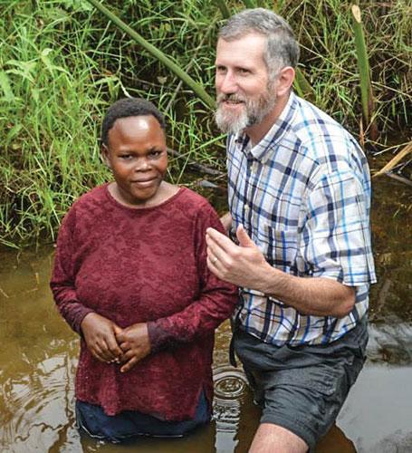 Jeff Cash prepares for a baptism in Uganda.