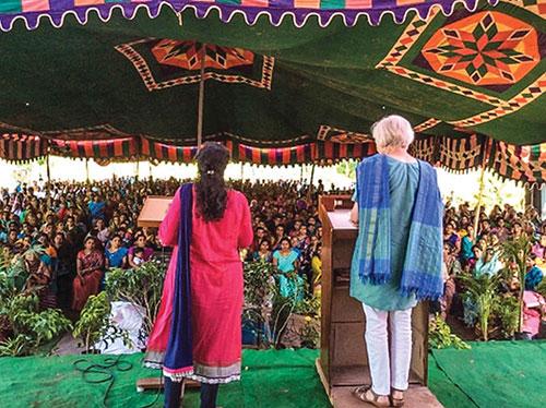 Leslie Coffey and her translator speak to hundreds of women during a recent gospel meeting in Kakinada