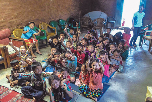 "Children flash ""thumbs up"" (and a pair of rabbit ears) during a day-long Bible program in Nepal's Goldhunga district"