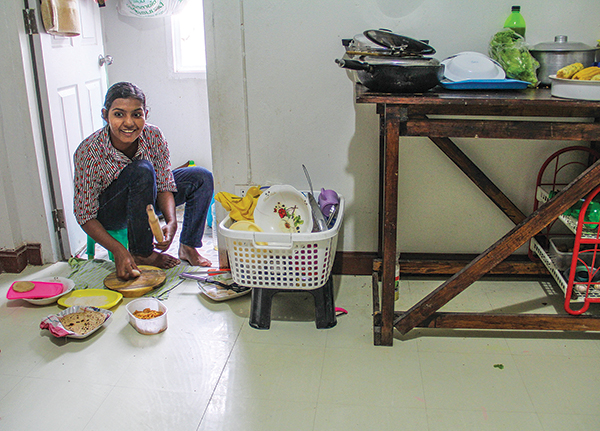 In the one-room apartment she shares with her husband and three children in Bangkok