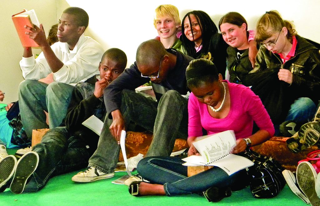 Young people of all races study the Bible together during the Southern Africa Bible College lectureship in 2009.