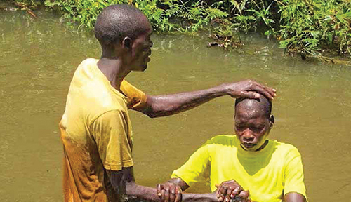 A Sudanese believer is baptized.