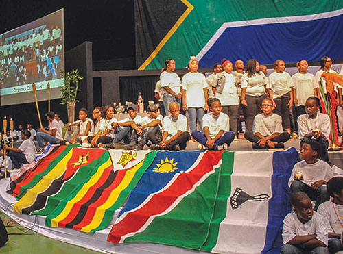 Young Christians sit on the stage of Heartfelt Arena in Pretoria