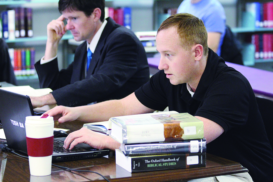 Anthony Odom and Bryan Cook attend class at Heritage Christian University in Florence