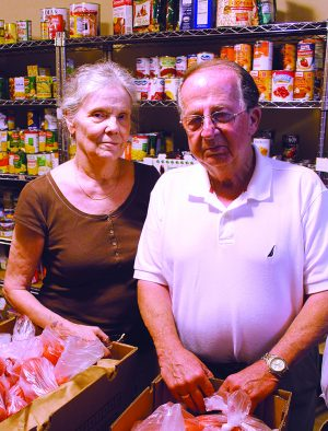 Sue Maynard, pictured with her husband, Ed, at the church food bank in 2013.