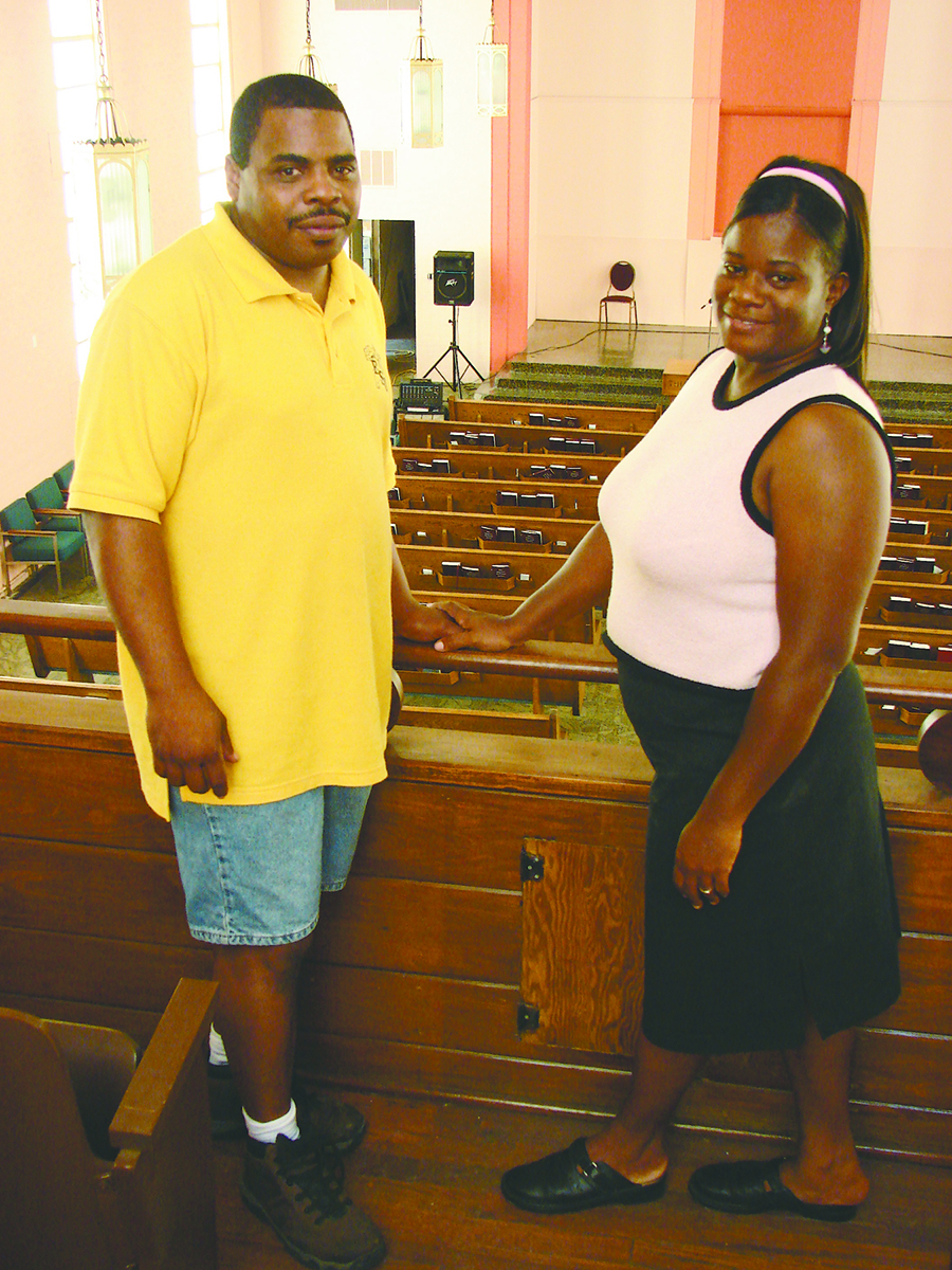 Charles and Angela Marsalis pose in the balcony of the Carrollton Avenue Church of Christ