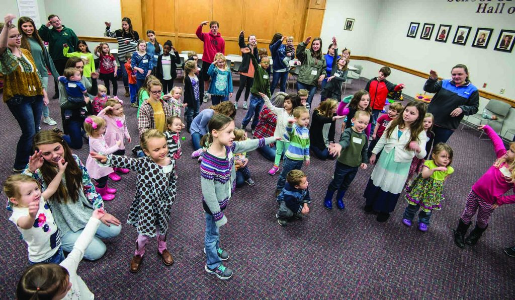 """Children play games and sing songs during a """"Kids Lectureship"""" event at the Bible Lectureship at Freed-Hardeman University. The lectureship also featured classes for teens."""